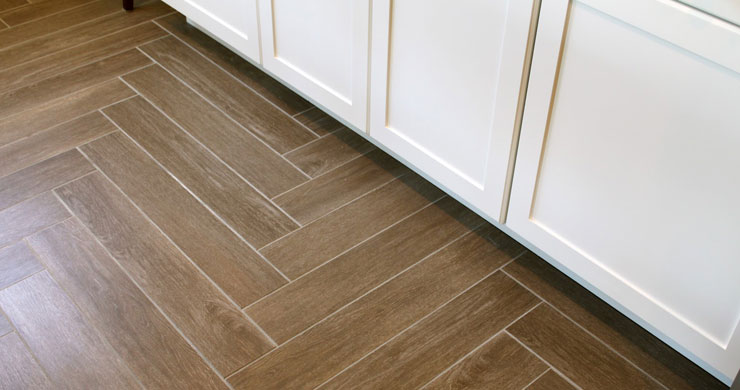 Tile that looks like wood vs hardwood flooring home for Hardwood floor tile kitchen