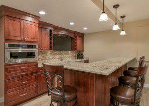 Full bar, kitchenette, bathroom Finished Basement Remodeling Geneva IL Sebring Design Build