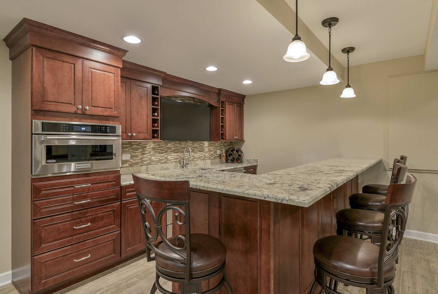 Full bar, kitchenette, bathroom Finished Basement Remodeling Geneva IL Sebring Services