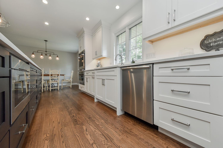 Open Floor Plan Kitchen, Living Room, White Cabinets - Sebring Services