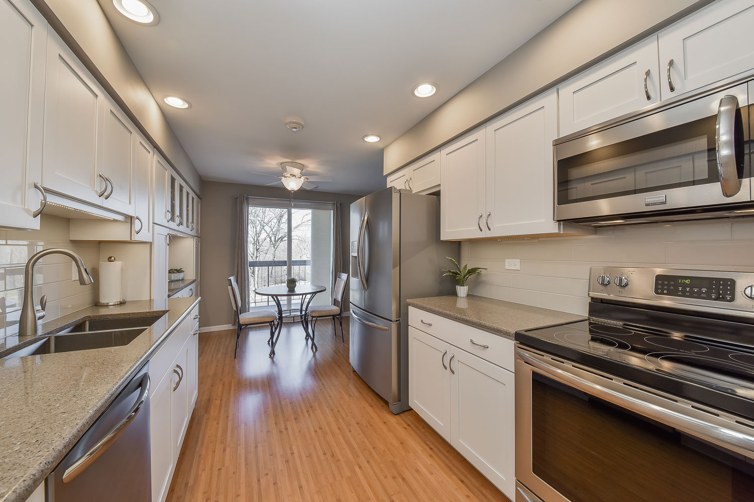 White Cabinets, Modern Clean Grey Paint, Subway Tile, Stainless Appliances - Sebring Services