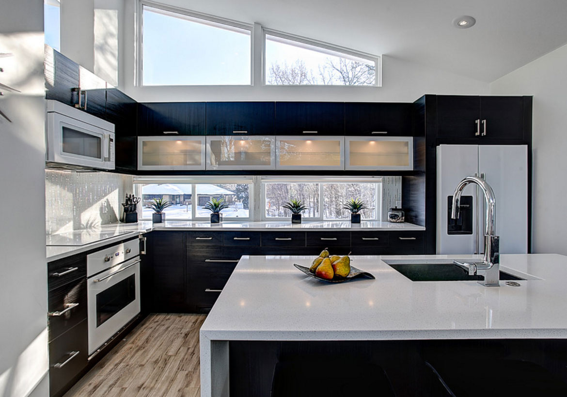 Black Stainless Appliances In White Kitchen