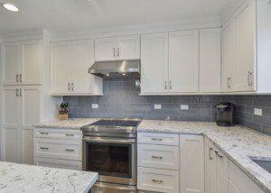 Homer Glen Kitchen Remodeling Project with white shaker cabinetry, quartz countertops, blue subway tile - Sebring Design Build