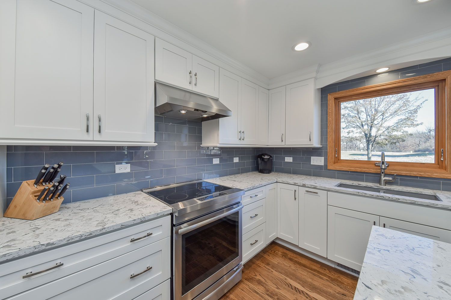 Homer Glen Kitchen Remodeling Project With White Shaker Cabinetry Quartz Countertops Blue Subway Tile