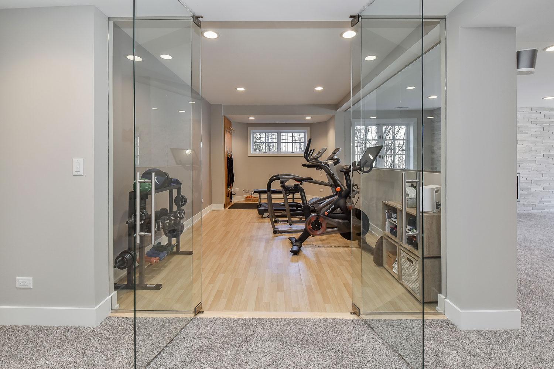 Wheaton Basement Finishing Project With Wet Bar, Home Gym, & Steam Bath - Sebring Design Build