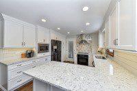 A cozy Naperville kitchen with white quartz countertops, stove focal point tile - Sebring Design Build