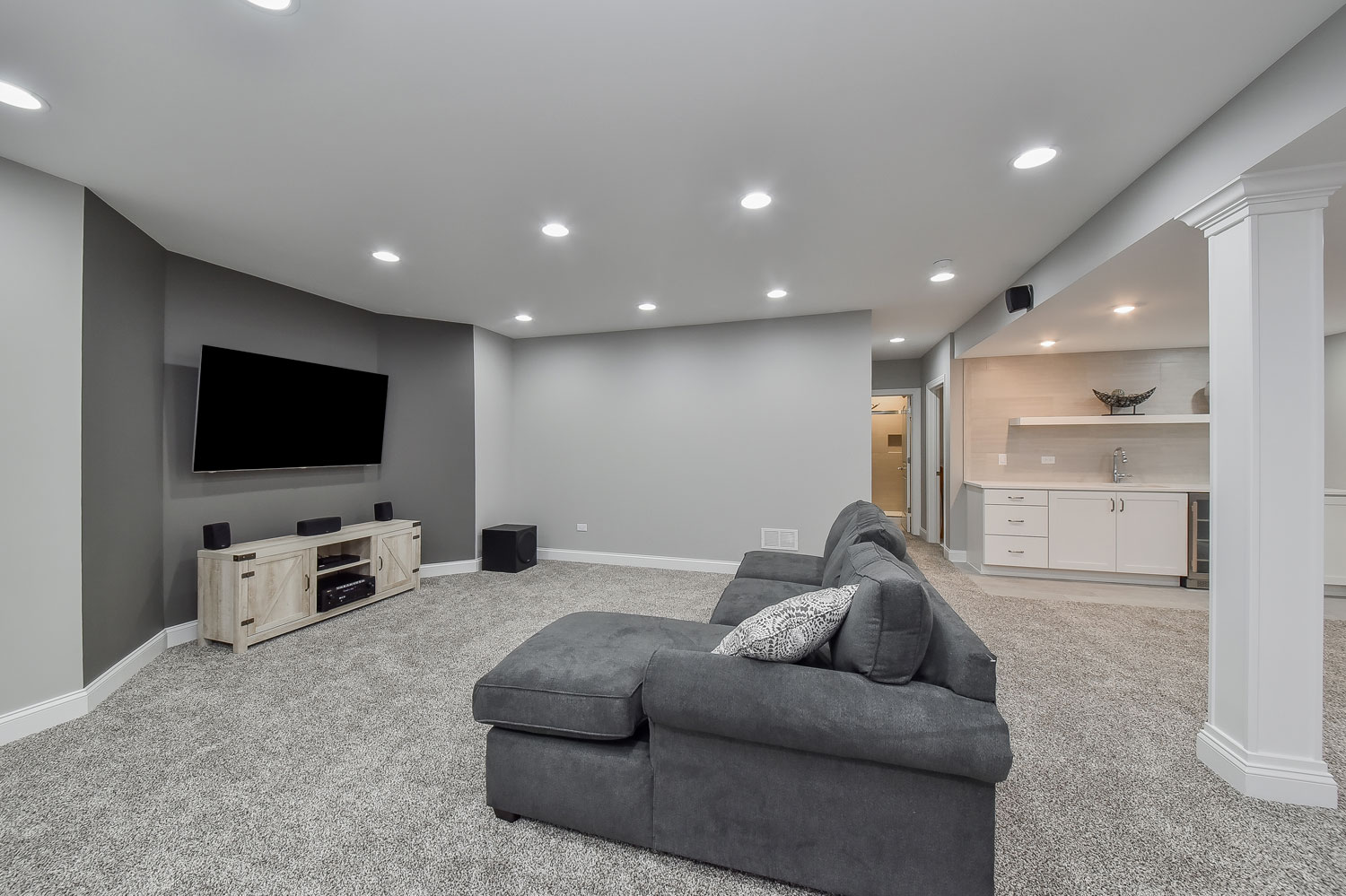 Downers Grove Basement Finishing Project, Grey Walls, Grey Carpet, White Wet Bar - Sebring Design Build