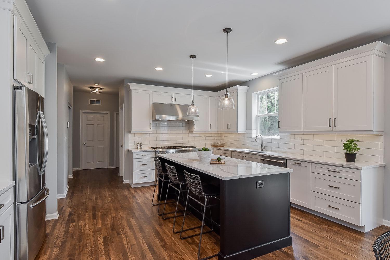 Plainfield Kitchen Remodel - White Cabinetry, White Subway Tile, Dark Island - Sebring Design Build