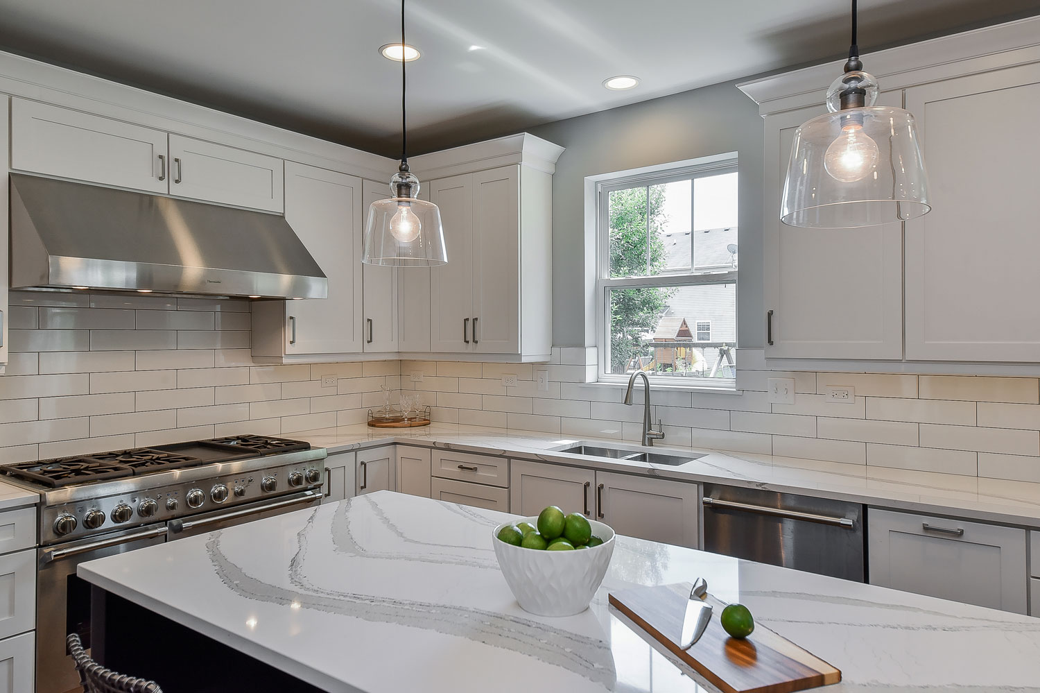 Plainfield Kitchen Remodel - White Cabinetry, White Subway Tile, Dark Island - Sebring Design Build